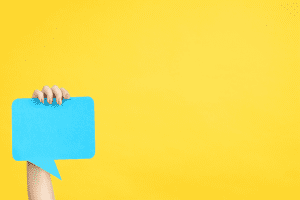 Blue speech bubble against yellow background