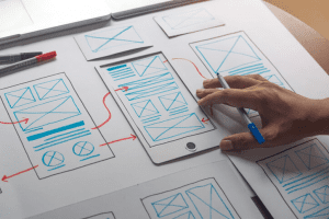 Person designing a website by hand