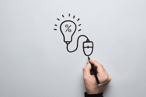 Person drawing lightbulb connected to a mouse
