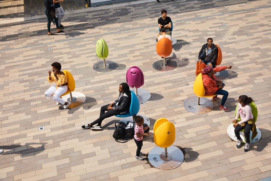 A group sits on colorful pods