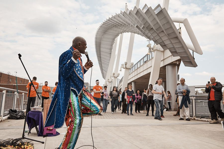 A singer performs outside Empire Outlets