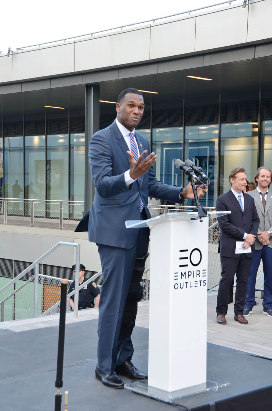 A speaker at an Empire Outlets event