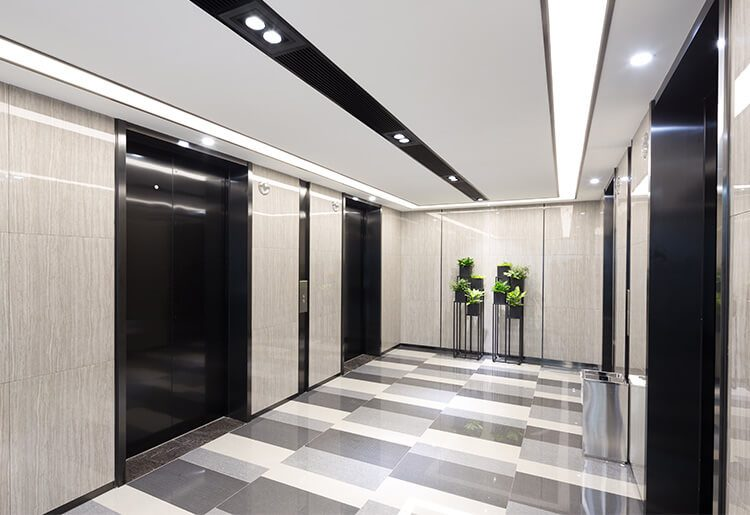 office cleaning in a hallway elevator