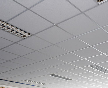 The ceiling of an office after it has received a professional ceiling tile cleaning.